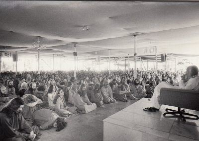 Bhagwan giving his daily discourse in Buddha Hall, Pune 1978