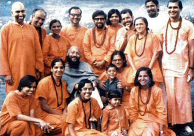 Early Seventies: Acharya Rajneesh sits with his first group of initiated sannyasins, in the Himalayas